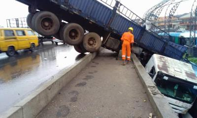 Lagos: Many escape death as Truck falls off Oshodi Bridge-TopNaija.ng