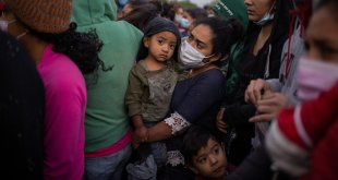 Young Migrants Crowd Shelters, Posing Test for Biden