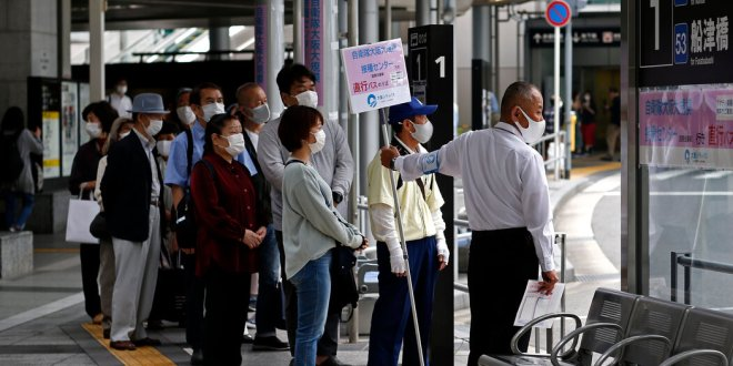 Japan extends a state of emergency until one month before the Olympics.