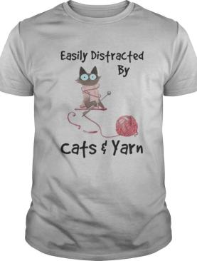 Easily distracted by white cats and yarn shirt
