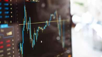 Tokyo stocks close higher on cheaper yen
