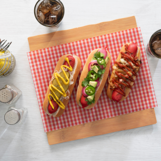 Wax Food Paper Gingham red and white holding three hot dogs
