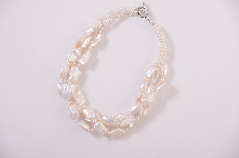 http://everyday-jewels.com/shop/white-freshwater-pearl-twist-necklace/