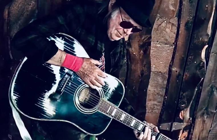 """Watch Neil Young play """"The Times They Are A-Changin'"""""""