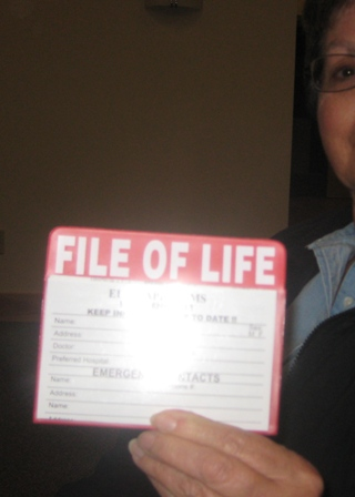 Diana Hein played hand model, holding up the sample File of Life pouch so I could take a picture of it for you.