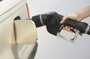 Woman Pumping Gas Into Car