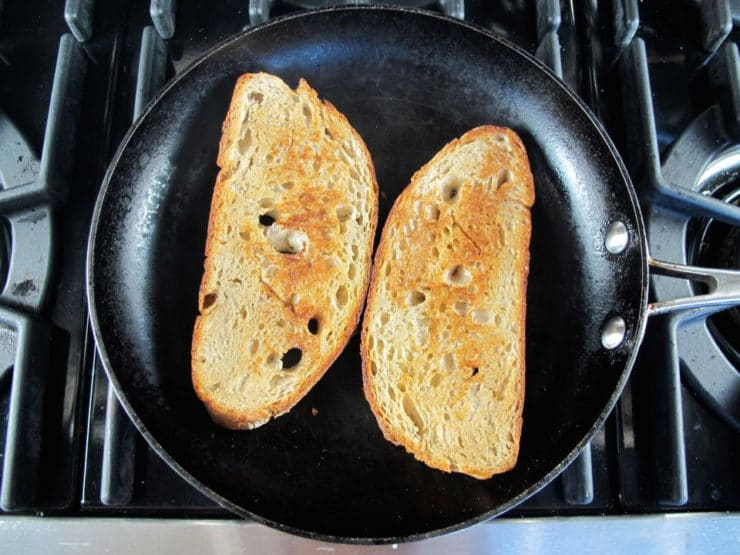 Toasting bread in a skillet.