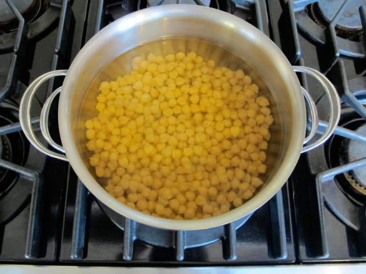 Quick soaking chickpeas in large pot on stovetop.