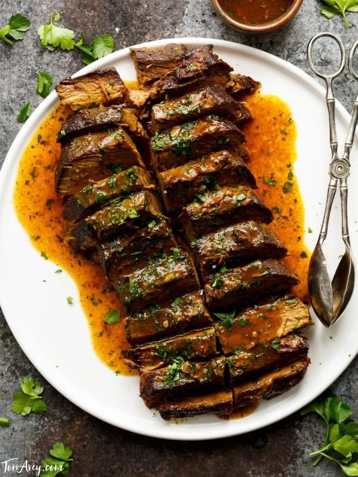 Savory Slow Cooker Brisket - Recipe with Video. Brisket Recipe with Onion, Garlic and Spices Made in the Crock Pot. Kosher for Passover.