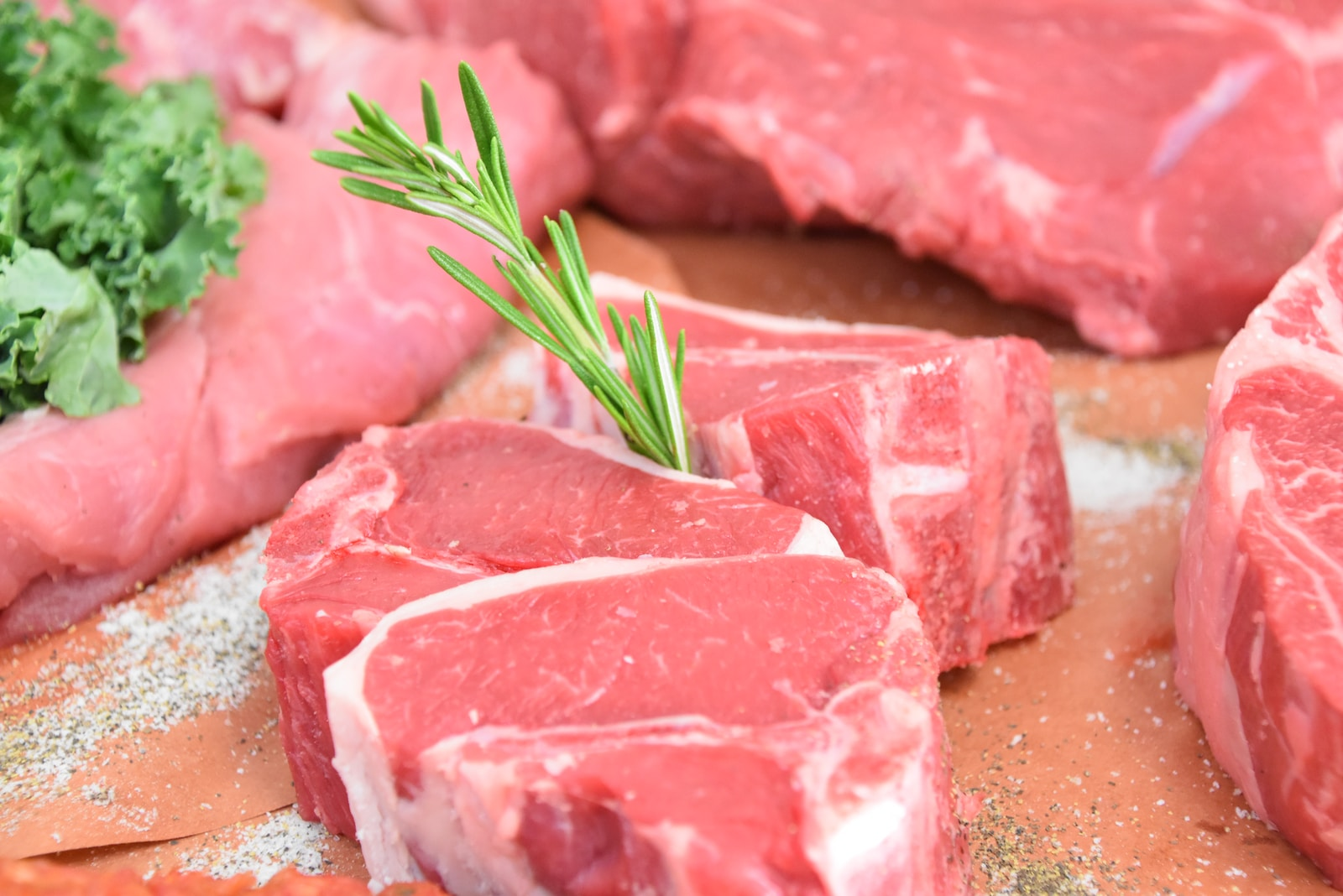 raw meat with green leaves