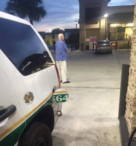 Elderly man acts as bodyguard as cop pumps gas