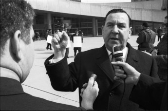 "Gerry Gallagher speaking to reporters during ""pro-development"" protest at Nathan Phillips Square. Photo by Leo Harrison. April 6, 1970. York University Libraries, Clara Thomas Archives and Special Collections, Toronto Telegram fonds, ASC50518."