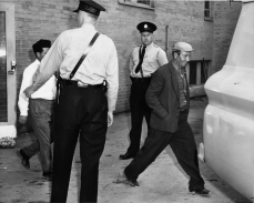 Construction workers being escorted into police wagon. Photo by Woods. June 20, 1961. York University, Clara Thomas Archives and Special Collections, Toronto Telegram fonds, ASC53033.