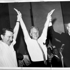 Bruno Zanini and Charles Irvine lifting Murray Cotterill's arms. Photographer unknown. June 1961. Archives of Ontario, Charles Irvine fonds.