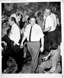 George Petta (front) and Charles Irvine (back) walking down aisle at Lansdowne Theatre. Photographer unknown. 1961. Archives of Ontario, Charles Irvine fonds.