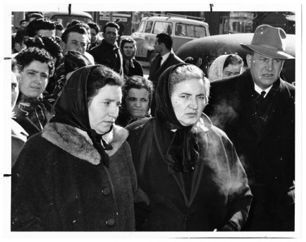 Italian women mourning Hoggs Hollow tunnellers during funeral at St. Agnes Catholic Church. Photo by Jack Judges. March 25, 1960. York University Libraries, Clara Thomas Archives and Special Collections, Toronto Telegram fonds, ASC50802