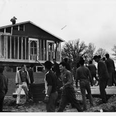 Strikers throwing projectiles at workers in residential project near Steeles and Bayview avenues. Photo by Jack Judges. June 12, 1961. York University Libraries, Clara Thomas Archives and Special Collections, Toronto Telegram fonds, ASC52961.