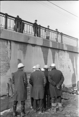 Norm Pike, Gerry Gallagher, and other inspecting a bridge building project on Gerrard Street. Photo by Bruce Reed. March 2, 1967. York University Libraries, Clara Thomas Archives and Special Collections, Toronto Telegram fonds, ASC52241.