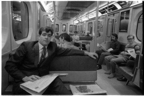 Norman Pike posing inside a subway car for a Toronto Telegram photo shoot. Photo by Bruce Reed. September 21, 1970. York University Libraries, Clara Thomas Archives and Special Collections, Toronto Telegram fonds, ASC54808.