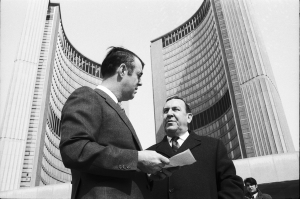 City Alderman Tony O'Donohue (left) speaking with Gerry Gallagher at Nathan Phillips Square. Photo by Leo Harrison. April 6, 1970. York University Libraries, Clara Thomas Archives and Special Collections, Toronto Telegram fonds, ASC50521.