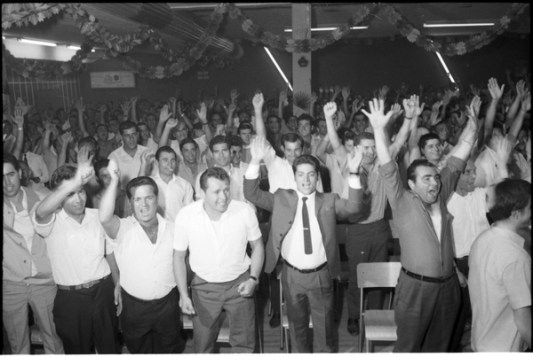 CFWU Local 1 workers cheering Bruno Zanini during meeting at the York Centre Ballroom. Photo by Jac Holland. July 14, 1969. York University, Clara Thomas Archives and Special Collections, Toronto Telegram fonds, ASC52183.