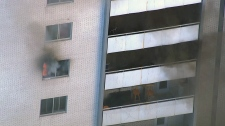 Woman rescued from balcony after Toronto fire