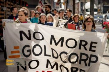 The crowd marched through Toronto's Financial District to greet Goldcorp head executives and shareholders outside of Goldcorp Inc's Shareholders Meeting held at the Sheraton Hotel.