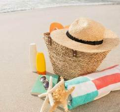 Beach accessories on sand at tropical beach