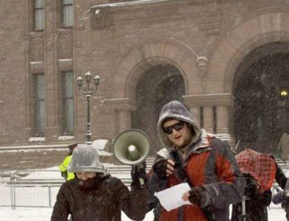 Frustrated York student Fil McCollum addresses the rally outside Queen's Park.
