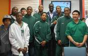 Pops stands with a Scarborough basketball team.