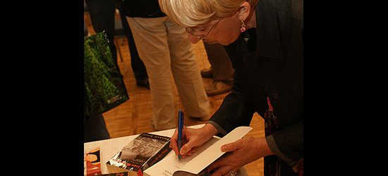 Rosemary Aubert, a Scarborough-based novelist known for her mystery series set in Toronto, autographs copies of her latest book, The Judge of Orphans.