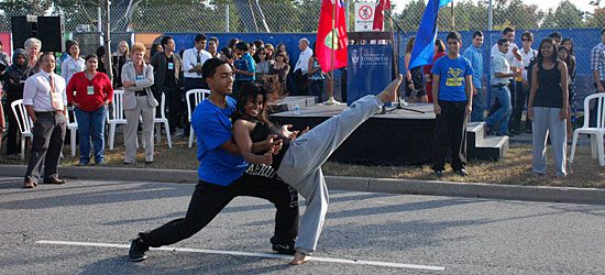 Students perform a dance at the ceremony after the ground has been broken.