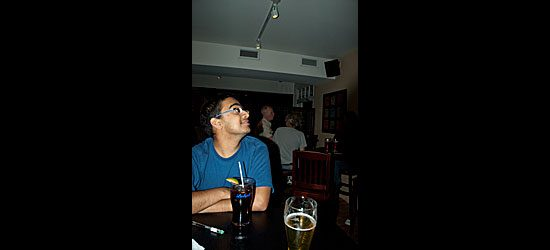 Gary Rodrigues watches the sports game on one of the Olde Stone Cottage's many flatscreen televisions.