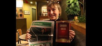 Kathleen Betts proudly holds up the two publications she's most recently been involved in: Good News Toronto Canadian Voices: Vol. 1.