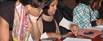 Jordanne Amos, student facilitator for UTSC's Imani black students' alliance, tutors a high school student.