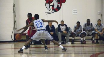 West Hill Warriors point-guard, Kevon Parchment #22, tries to drive past defending Laurier player, Daniel Mullings # 22.