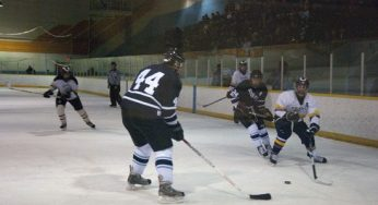King Academy's Phil Janovski #5 is challenged by two defending Porter players; James V. #44, and assistant captain, Jake Stroscher #24.