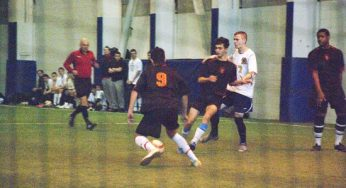 Victoria Park's #10 taps a pass to a teammate.