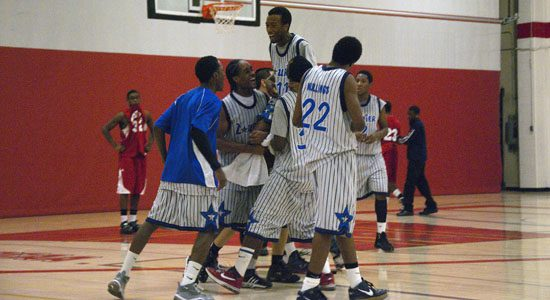 Sir Wilfrid Laurier Blue Devils celebrate a tight victory over the West Hill Warriors. Travis Sargeant #11 is lifted onto his teammates shoulders.