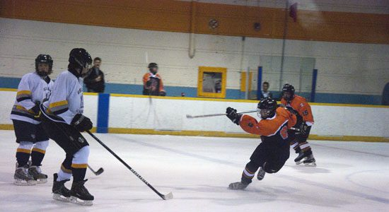 Bendale forward, Chris Pearce #9, crosses the blue line, rips a slap shot past two Lions defenders; Daily and Iserhoff.