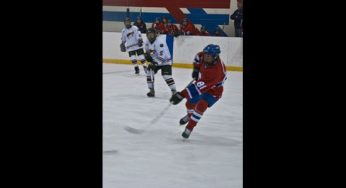 An Agincourt Canadian clears the zone with a stretch pass.