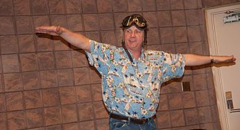 Jim Parker flys around the library while singing to the kids in the audience at the Malvern Public Library