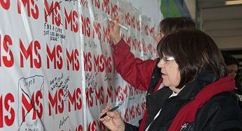 Supporters sign the MS wall as a beacon of hope.