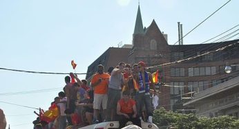 Revellers left the streets and climbed on top of streetcars that were left stranded in the street
