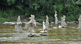 Toronto photographer Peter Riedel's 39 rock sculptures, discovered on the weekend in the Humber River near the old Mill, silently refuse to give up the secret to how they stay standing. Riedel, though, says it's like fitting a puzzle together.