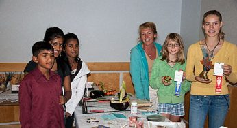 Scarborough Garden and Horticultural Society youth leader Jean Cope, third from right, mentors about 15 kids in gardening. Cope was at the Scarborough Garden and Horticultural Society's annual flower show, held at the Scarborough Village Community Centre on Sept. 11.