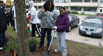 Genese Johnson and daughter Shyvonne help make a difference in their community. Kids from the building at 3181 Eglinton Ave. E. joined members of Toronto Anti-Violence Intervention Strategy (TAVIS) to beautify the building's courtyard, have some fun and build relationships on Saturday.