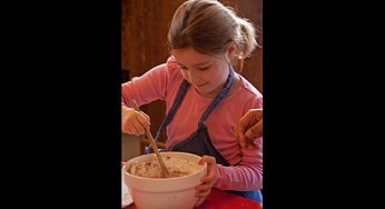 Saige Tsolakis, 6, mixes ingredients to make a Victorian dessert. She took part in a baking workshop with other children at the Scarborough Museum Dec. 3, as part of the museum's Festive Christmas weekends, which run the first three weekends in December.