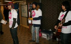 Tokens4Change volunteers play music and encourage TTC riders to donate tokens on Feb. 11. The tokens were collected for Youth Without Shelter.