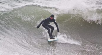 On a fall day in the Scarborough Bluffs, a surfer enjoys his morning by riding a wave. Though surfing is mostly known as a summer sport, in Toronto the waves are better in the fall and winter.